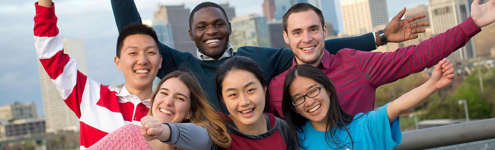 Image of students together by Philadelphia skyline