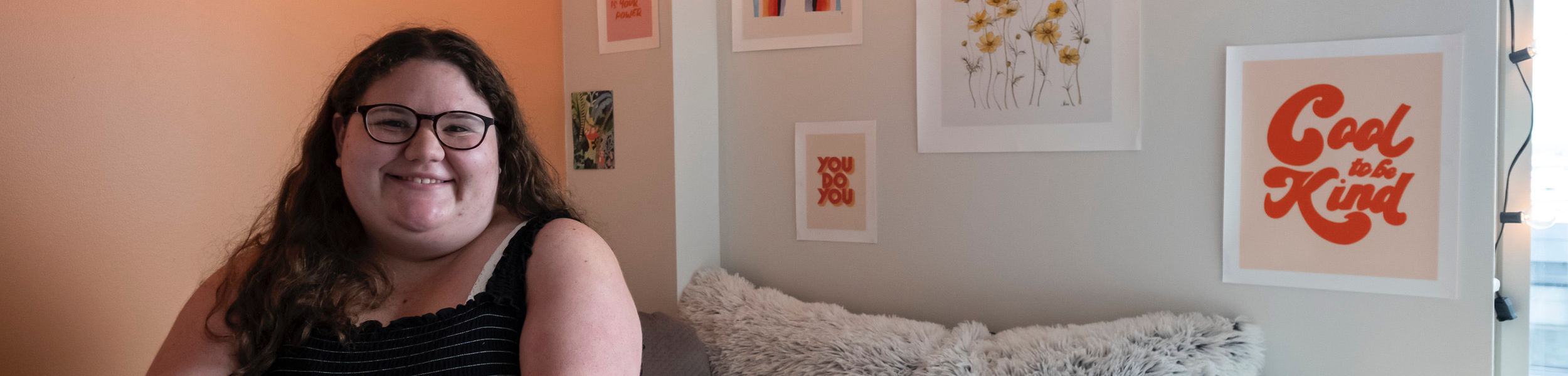 Student with peach-themed room